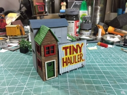 160402_tinyhauler_sign_and_tinyhouse.jpg