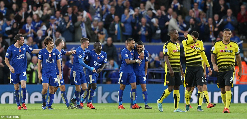 Leicesters players celebrate their lead while Watfords dejected players