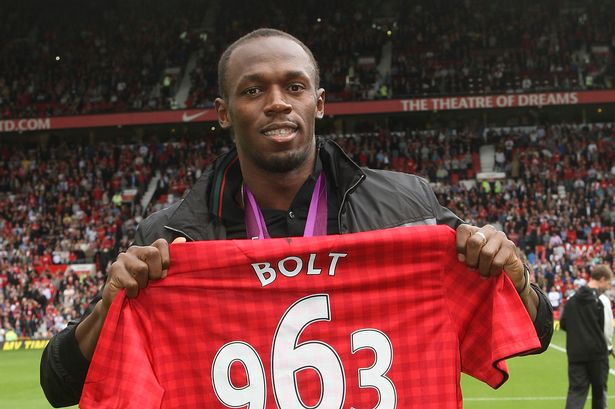 Bolt receives a United shirt at Old Trafford in 2012