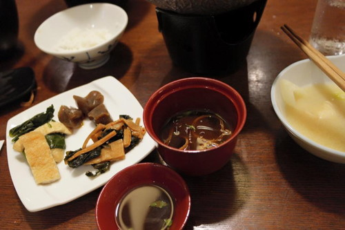 Miso soup with fied tofu and pickled vegtables