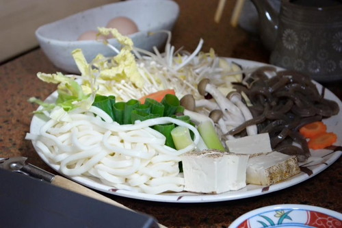 Our pile of local vegetables and noodles to be cooked in the pot with our thin sliced steak