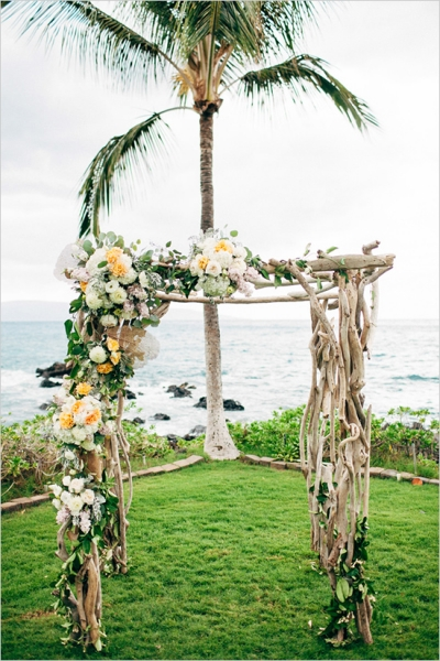 flowercoveredwoodweddingarch.jpg